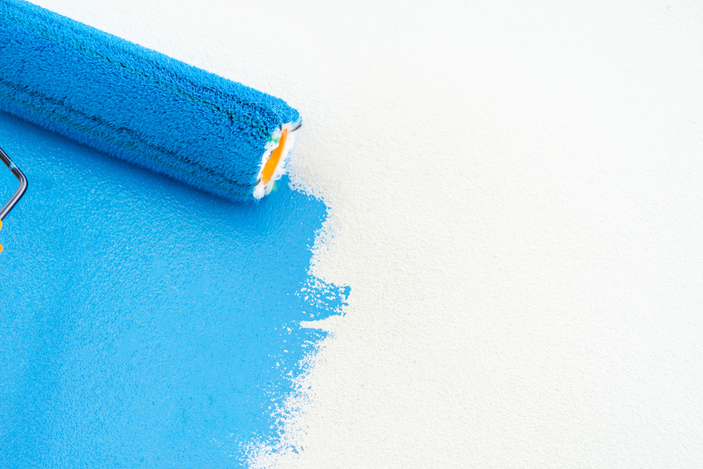 Exterior-house-painting-service-blue-roller-on-white-background